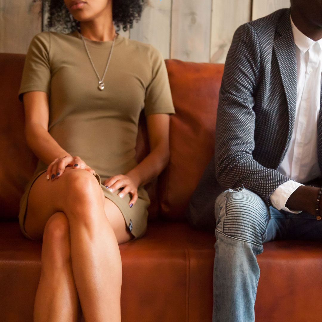 separted Couple Sitting on Couch Discussing Divorce